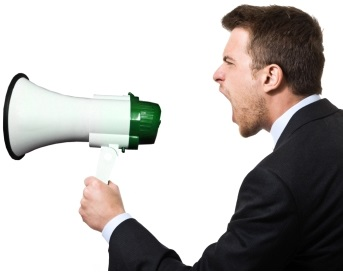 businessman shouting on the megaphone